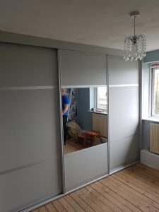 Three panel sliding wardrobe in