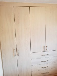 Wardrobe with four drawer linen press.