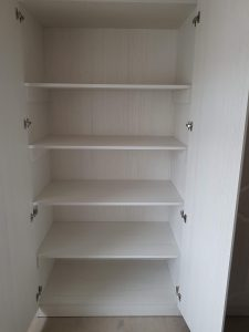 Shelved cupboard showing full carcass system.