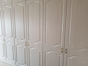 Hacienda white fitted wardrobes.